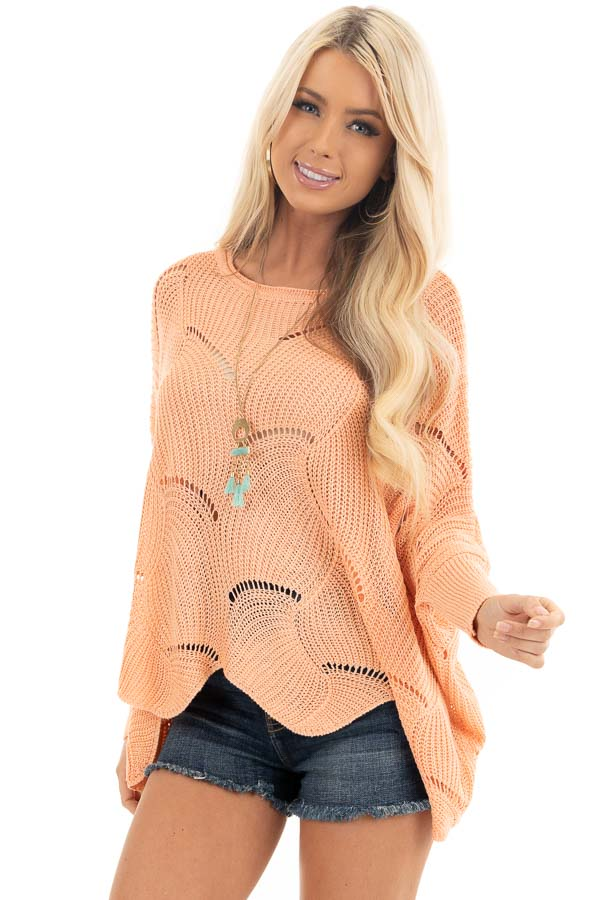 Bright Peach Round Neck Sweater with Scalloped Edge Detail front close up