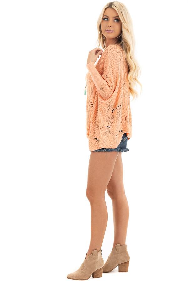 Bright Peach Round Neck Sweater with Scalloped Edge Detail side full body