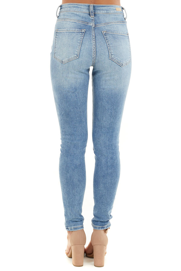 Medium Wash Lightly Distressed High Rise Skinny Jeans back view