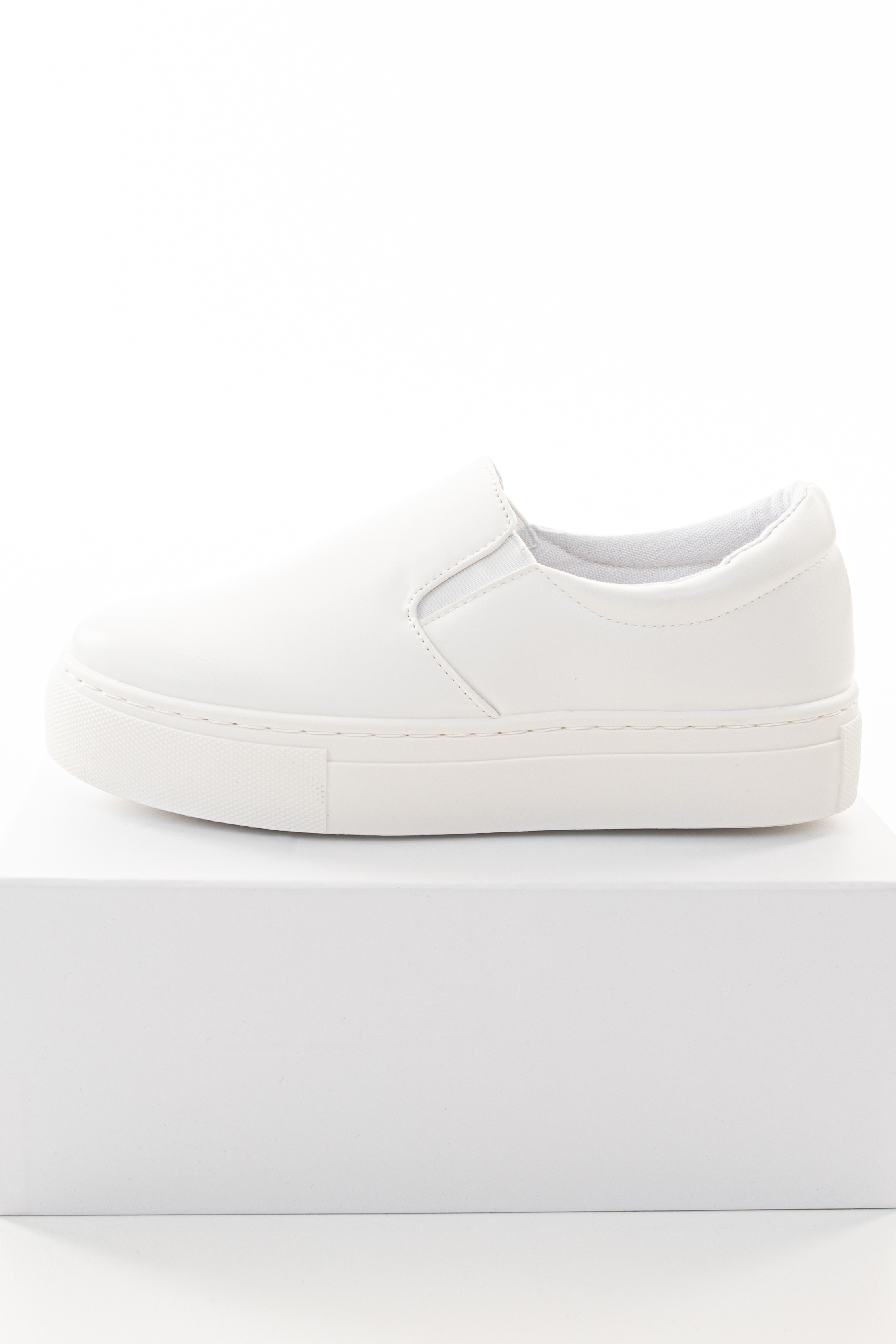 White Faux Leather Slip On Sneakers