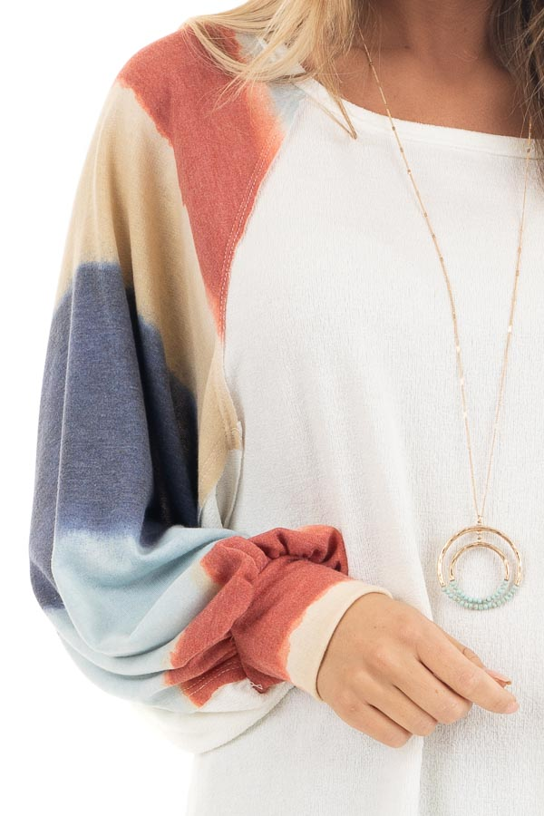 Ivory Soft Knit Top with Multi Colored Long Batwing Sleeves detail