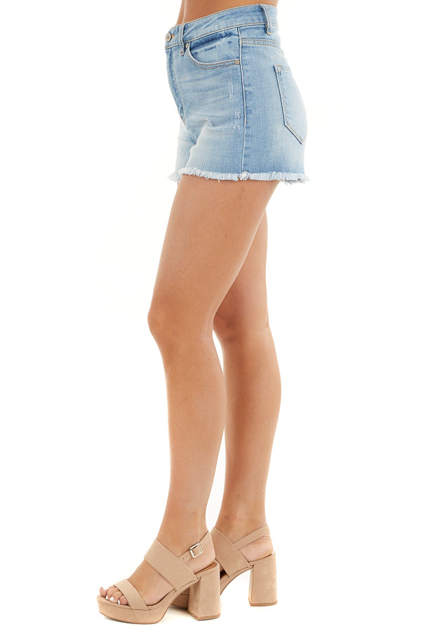 Medium Wash High Rise Denim Shorts with Frayed Detail side view