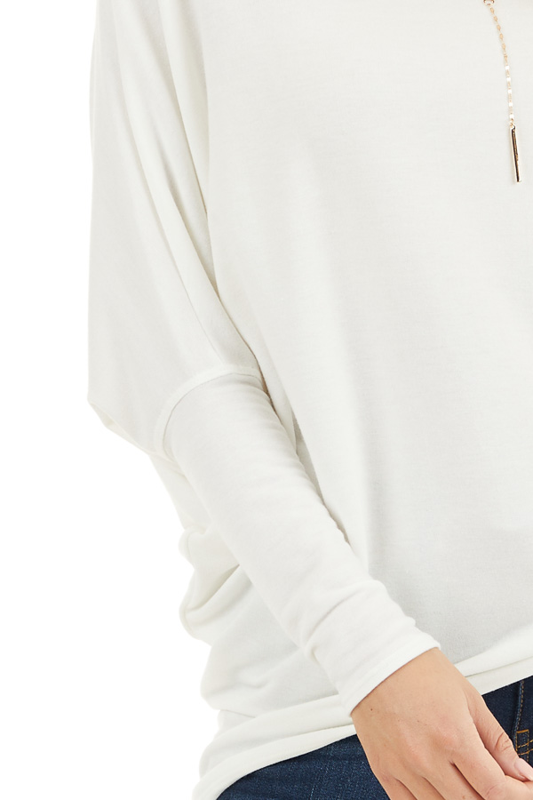 Off White Round Neck Top with Long Dolman Sleeves detail
