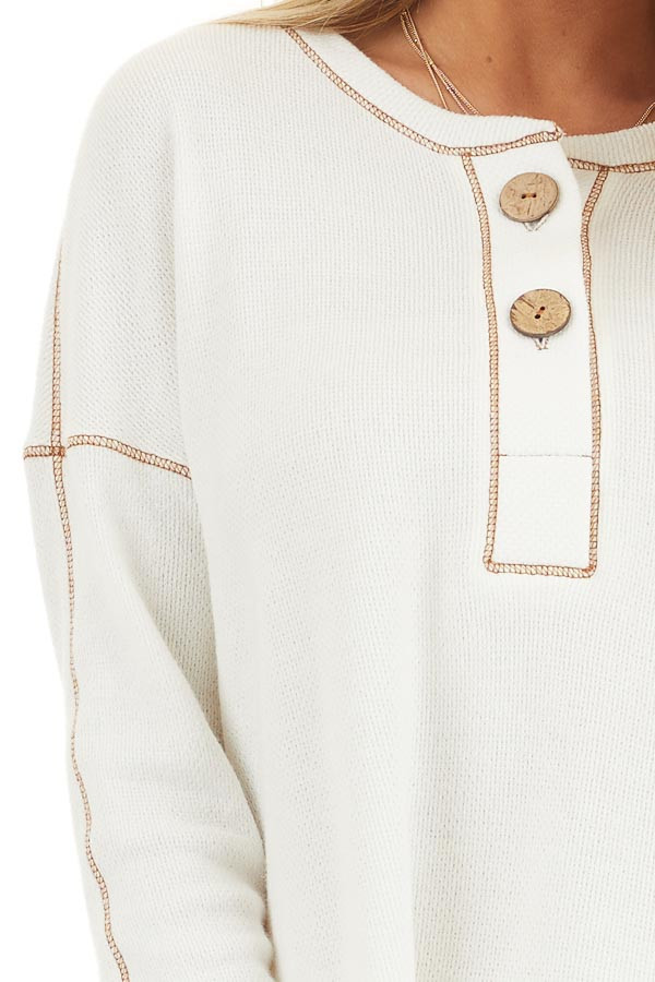 Off White Textured Knit Henley Top with Exposed Stitching detail
