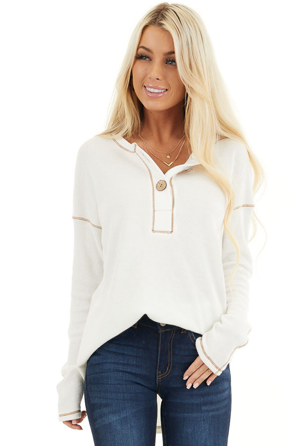 Off White Textured Knit Henley Top with Exposed Stitching front close up