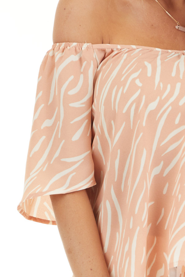 Peach and Cream Printed Off the Shoulder Flowy Top detail