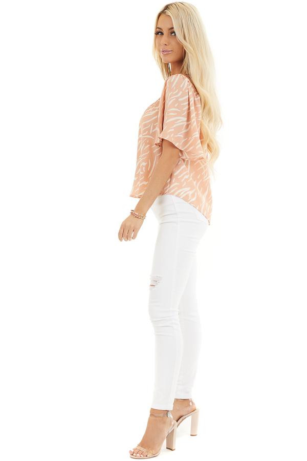 Peach and Cream Printed Off the Shoulder Flowy Top side full body