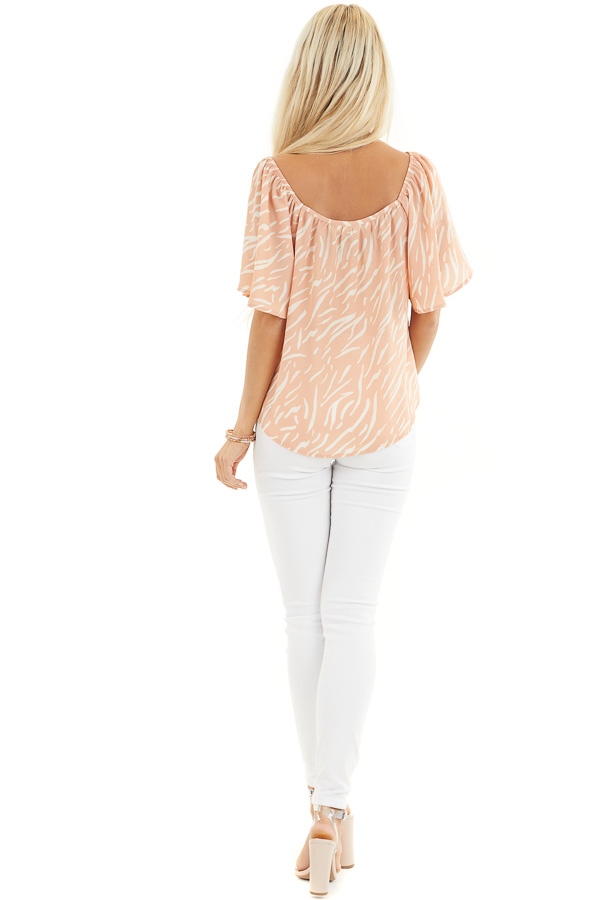 Peach and Cream Printed Off the Shoulder Flowy Top back full body