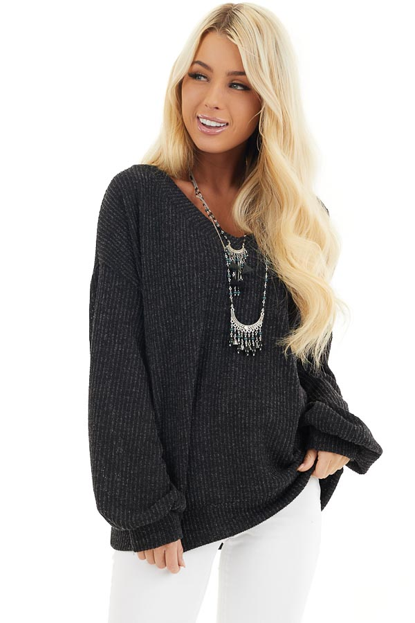 Black Textured Knit Top with Long Sleeves and V Neckline front close up