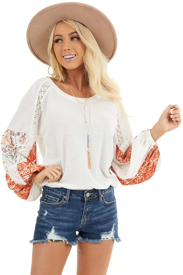 Off White Waffle Knit Top with Printed Sleeves and Lace front close up