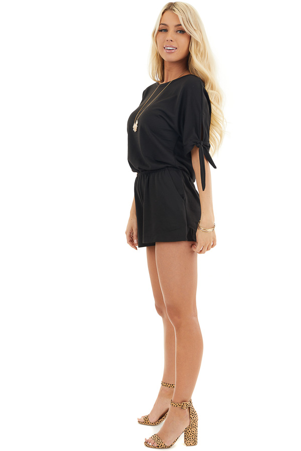 Black Short Sleeve Romper with Sleeve Ties and Pockets side full body