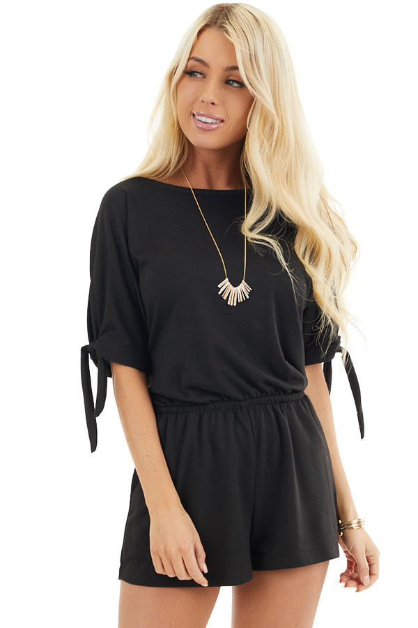 Black Short Sleeve Romper with Sleeve Ties and Pockets front close up