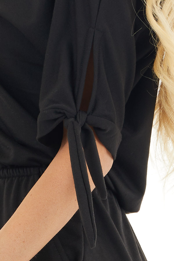 Black Short Sleeve Romper with Sleeve Ties and Pockets detail