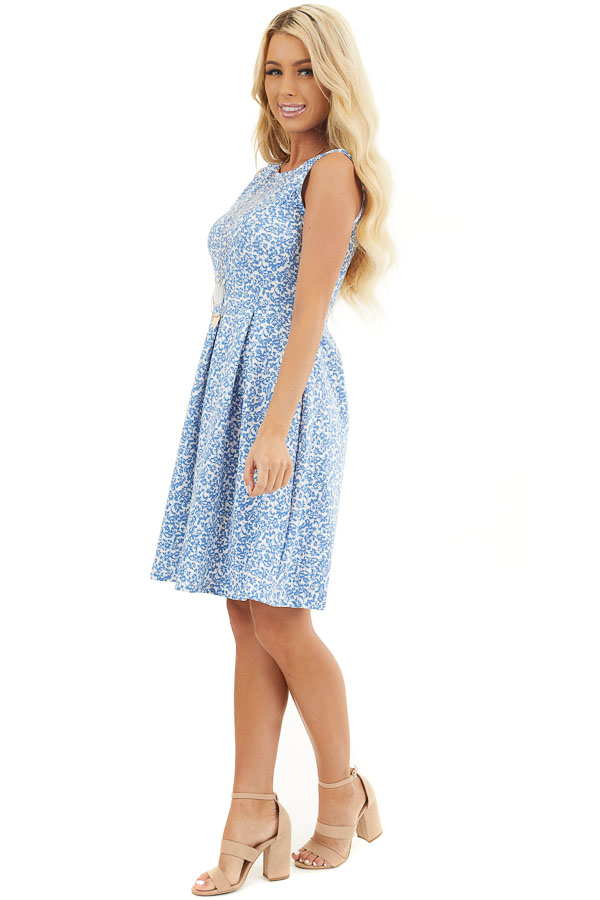 Blue and Ivory Floral Sleeveless Dress with Pleated Skirt side full body