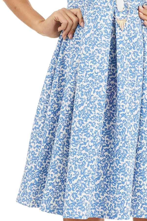 Blue and Ivory Floral Sleeveless Dress with Pleated Skirt detail
