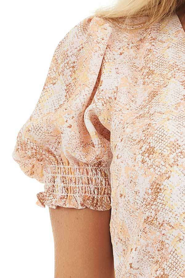 Peach and Ivory Snake Print Wrap Dress with Short Sleeves detail