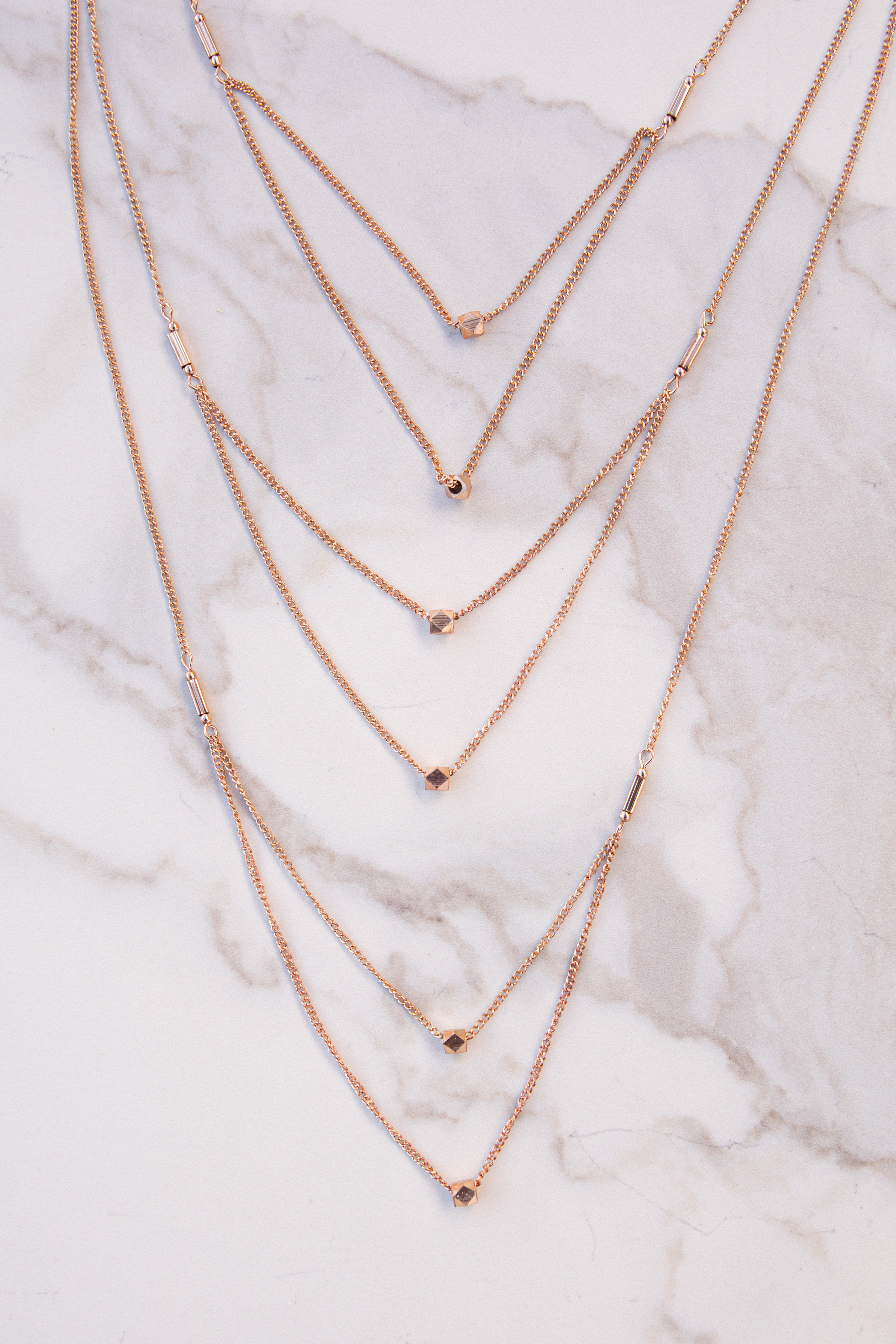 Rose Gold Layered Necklace with Metallic Geometric Beads