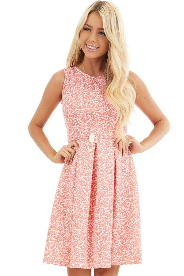 Coral and Ivory Floral Sleeveless Dress with Pleated Skirt front close up