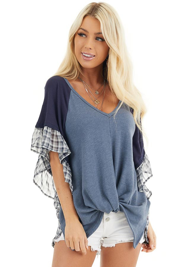 Navy and Dusty Blue Top with Plaid Print and Twist Detail front close up