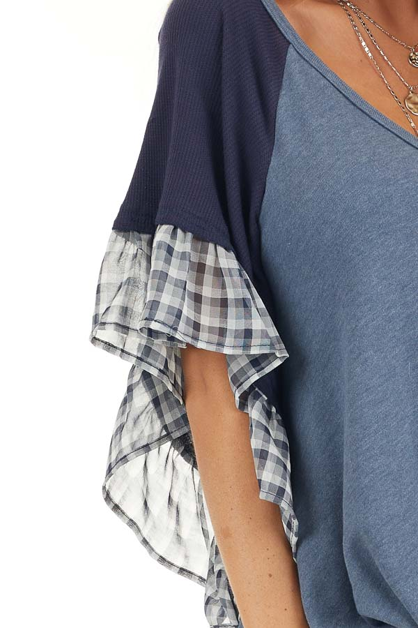 Navy and Dusty Blue Top with Plaid Print and Twist Detail detail