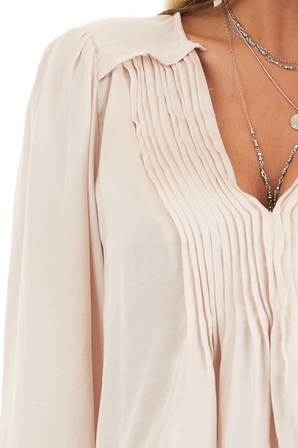 Pale Pink Long Sleeve Pleated Satin Top with V Neckline detail