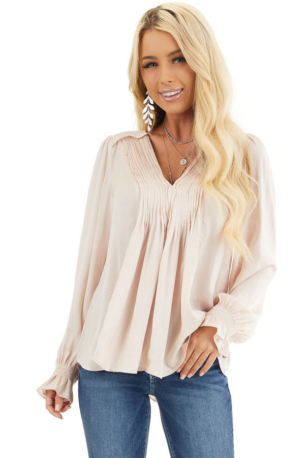 Pale Pink Long Sleeve Pleated Satin Top with V Neckline front close up