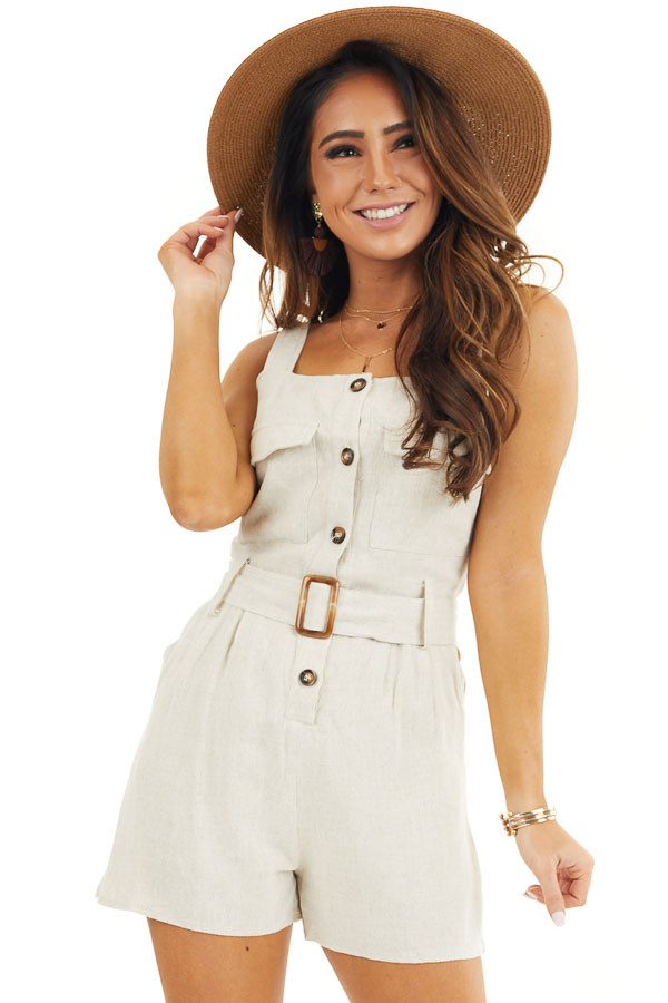 Cream Sleeveless Button Down Romper with Marbled Belt Buckle front close up
