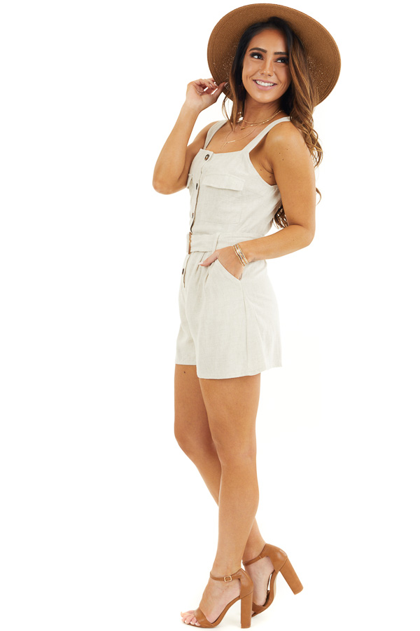 Cream Sleeveless Button Down Romper with Marbled Belt Buckle side full body