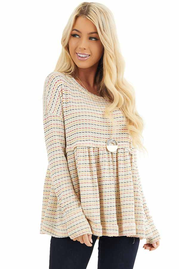 Multicolor Striped Babydoll Style Knit Top with Long Sleeves front close up
