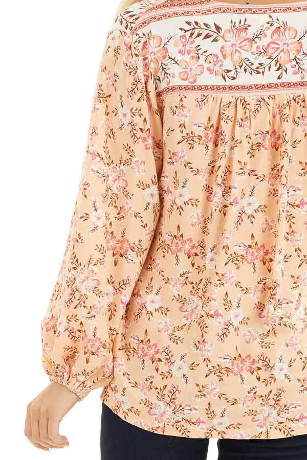 Peach and Ivory Floral Print Surplice Top with Long Sleeves detail