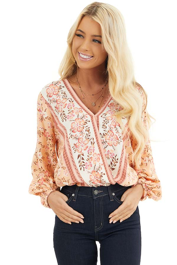 Peach and Ivory Floral Print Surplice Top with Long Sleeves front close up