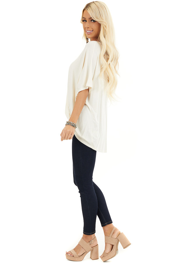 Cream Knit Top with V Neckline and Twisted Front Detail side full body
