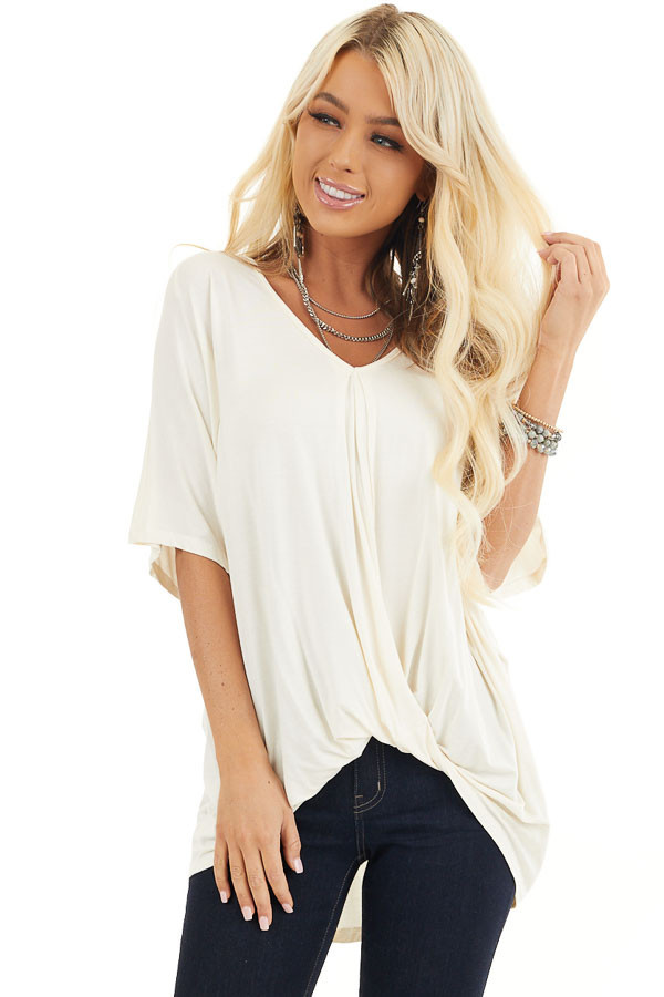 Cream Knit Top with V Neckline and Twisted Front Detail front close up