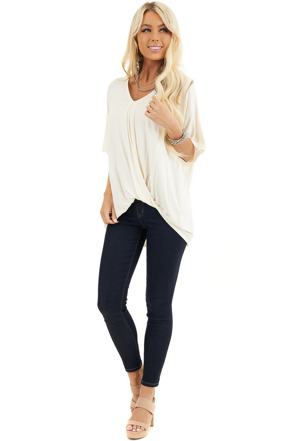 Cream Knit Top with V Neckline and Twisted Front Detail front full body