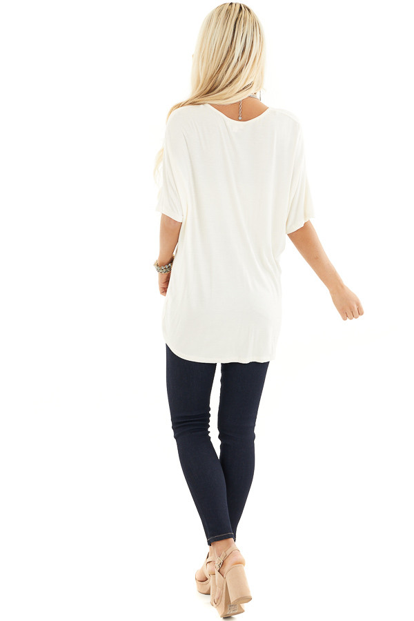 Cream Knit Top with V Neckline and Twisted Front Detail back full body