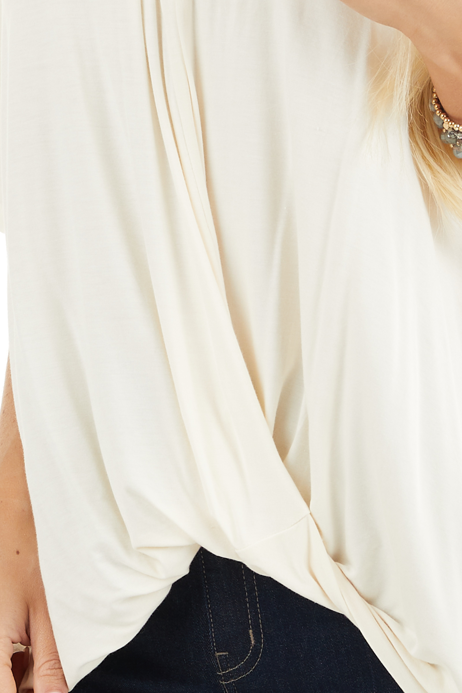 Cream Knit Top with V Neckline and Twisted Front Detail detail