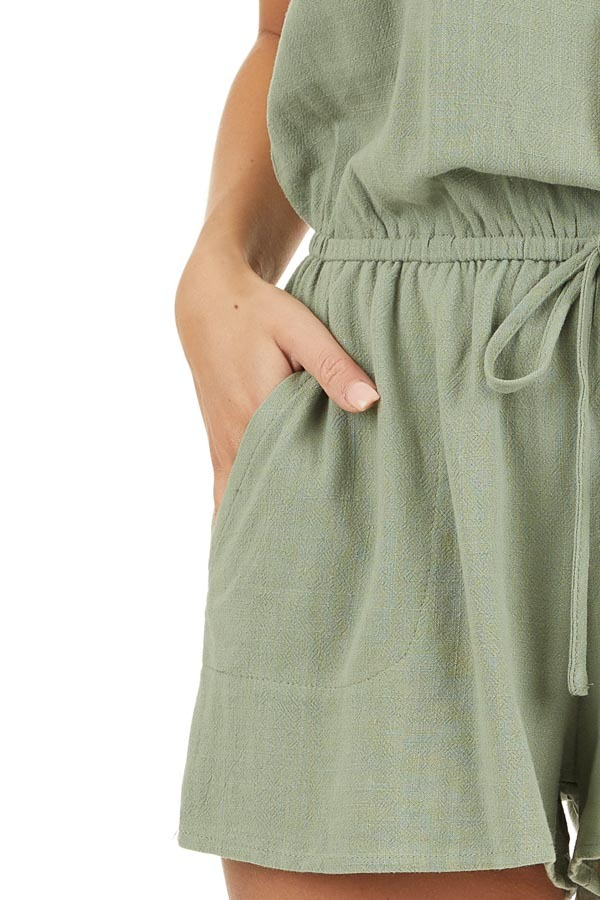 Sage Sleeveless Romper with Elastic Waist and Pockets detail