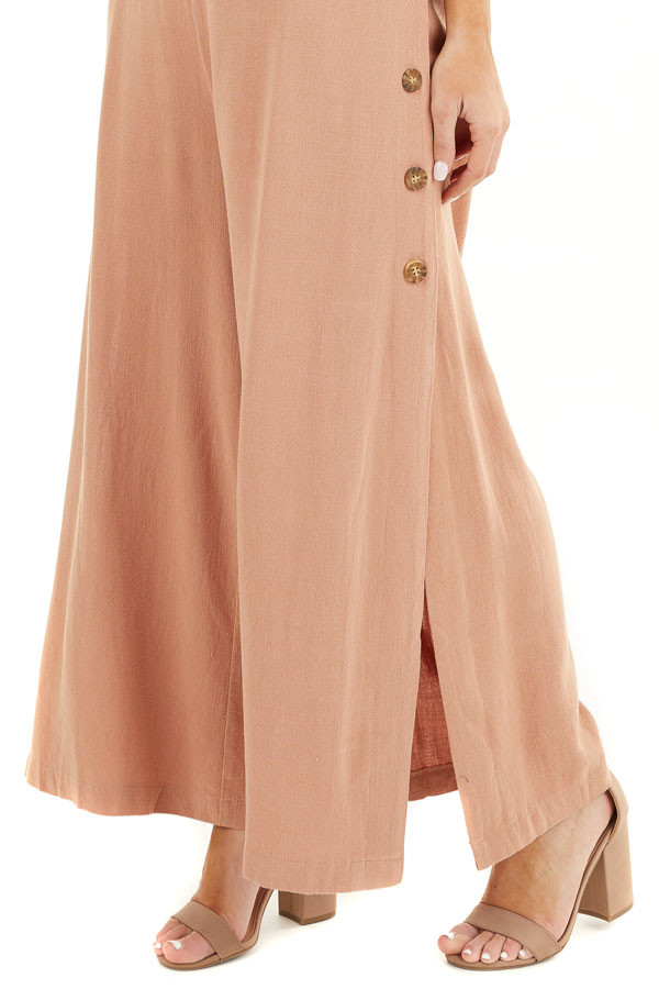 Terracotta Sleeveless Jumpsuit with Button Up Leg Slits detail