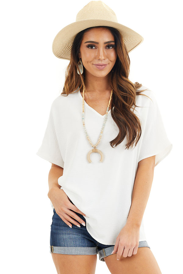 Off White Loose Blouse with V Neckline and Short Sleeves front close up