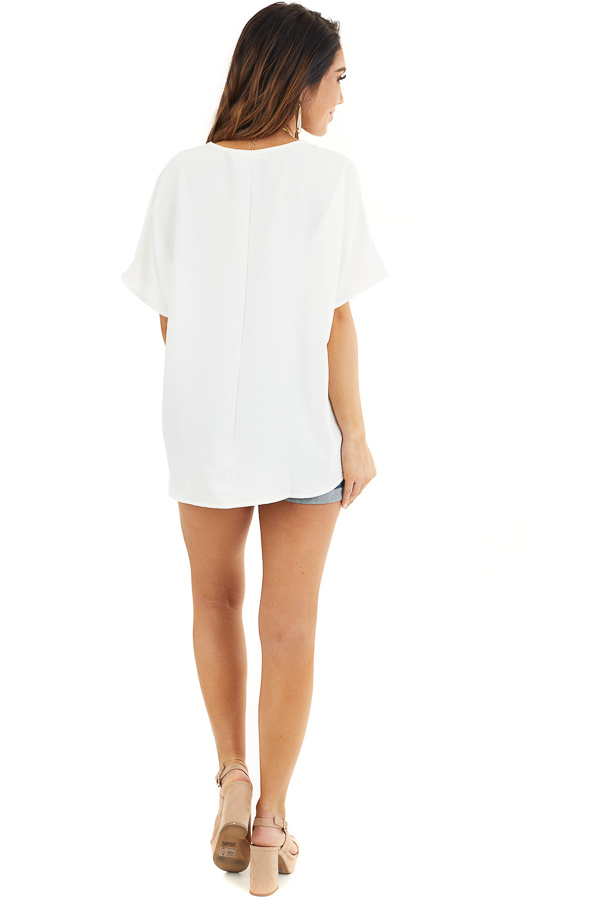 Off White Loose Blouse with V Neckline and Short Sleeves back full body