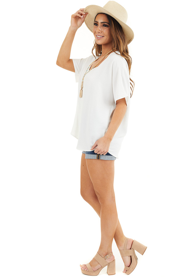Off White Loose Blouse with V Neckline and Short Sleeves side full body