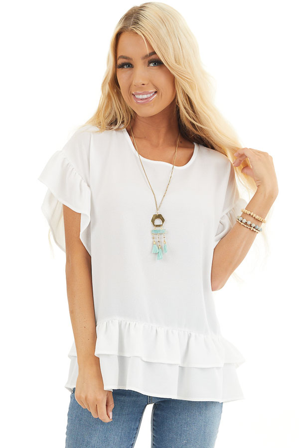 Ivory Peplum Top with Round Neckline and Ruffle Sleeves front close up