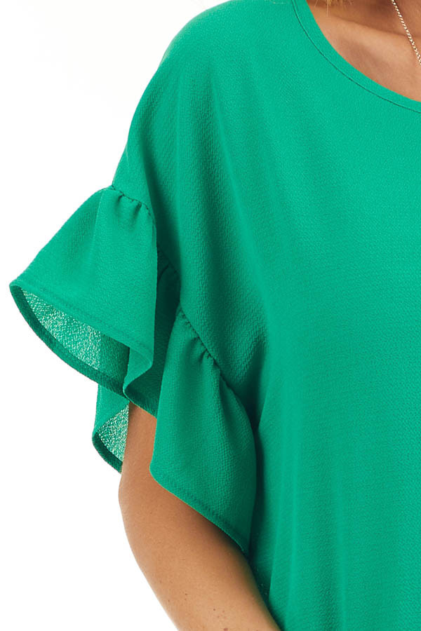 Green Peplum Top with Round Neckline and Ruffle Sleeves detail