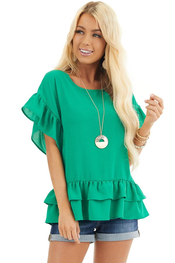 Green Peplum Top with Round Neckline and Ruffle Sleeves front close up