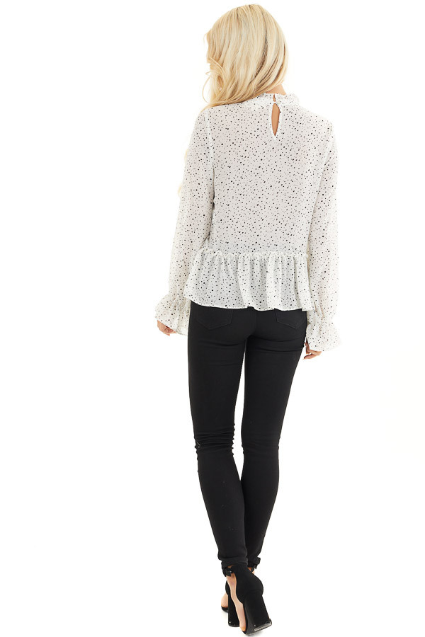 Ivory Polka Dot Top with Mock Neck and Ruffle Details back full body