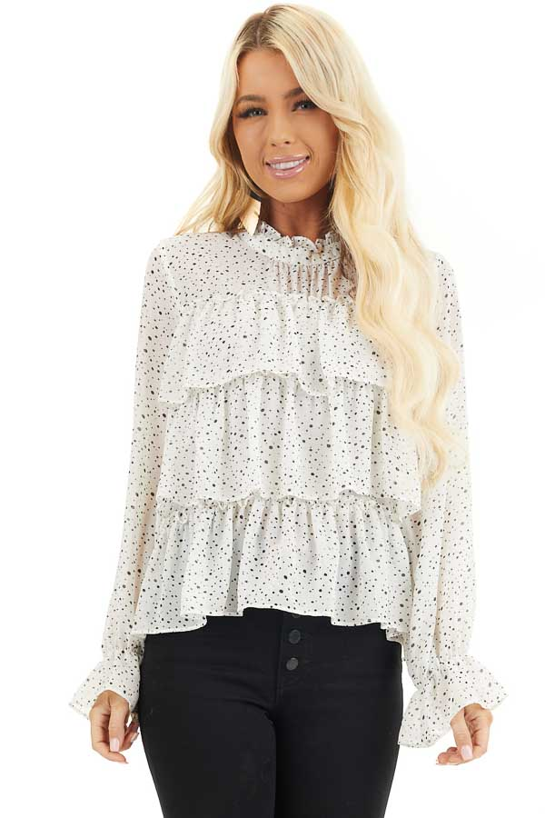 Ivory Polka Dot Top with Mock Neck and Ruffle Details front close up
