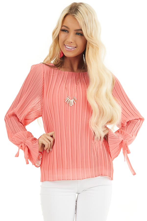 Coral Long Sleeve Top with Round Neckline and Pleat Details front close up