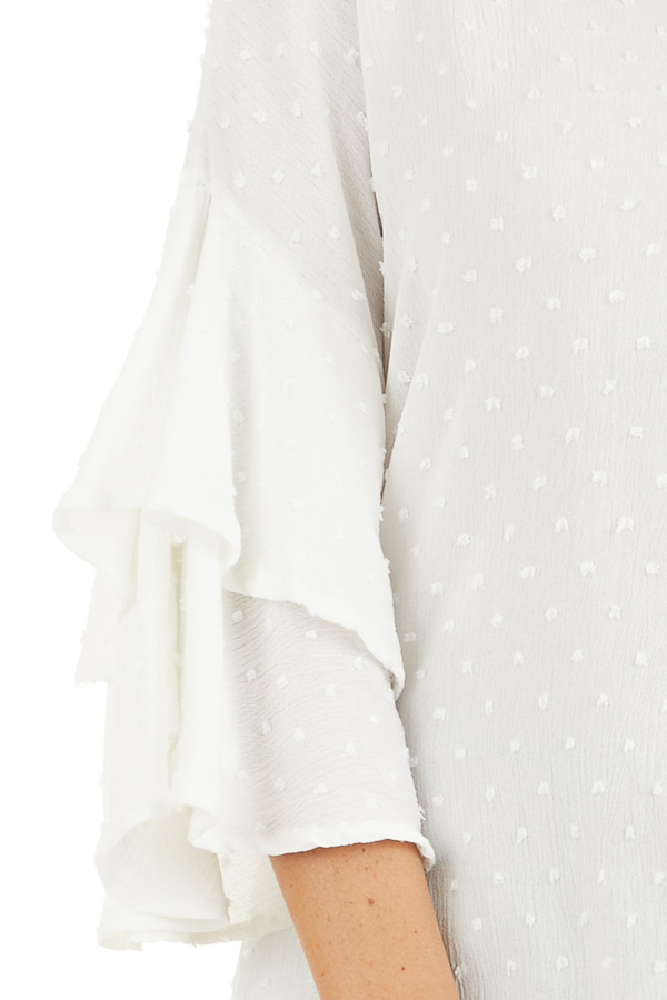 Off White Swiss Dot Top with 3/4 Sleeves and Ruffle Detail detail
