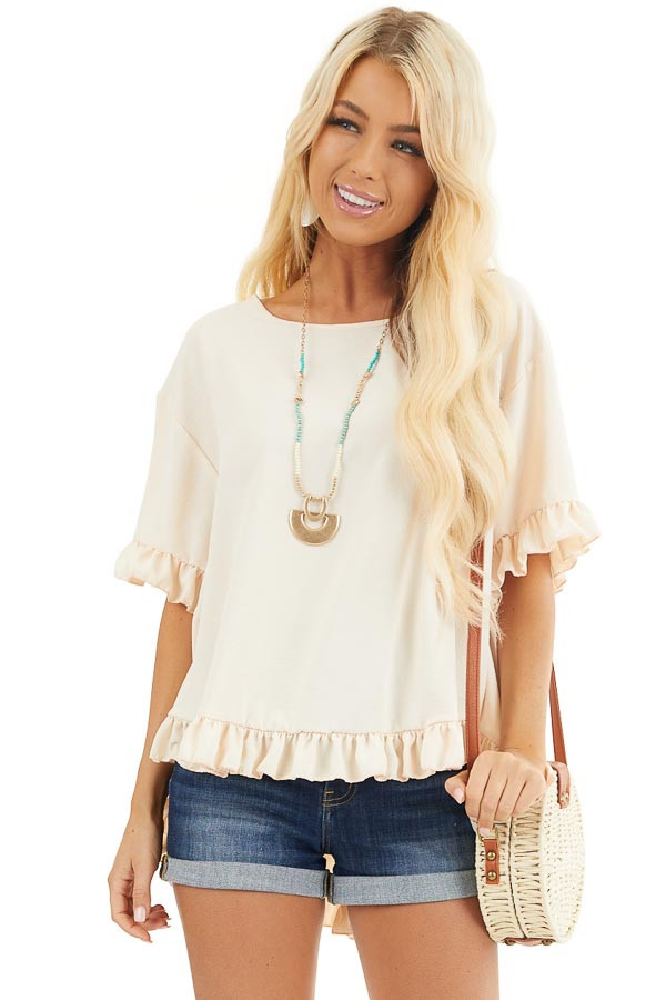 Champagne Short Sleeve Woven Top with Hi Low Ruffle Hemline front close up