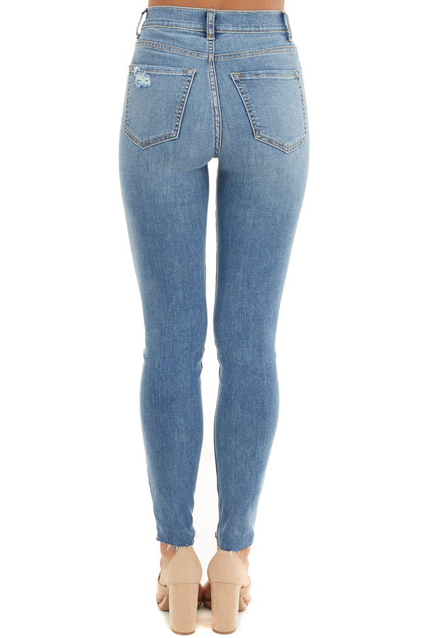 Light Denim High Rise Cropped Skinny Jeans with Raw Hem back view